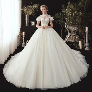 Vintage / Retro Ivory See-through Wedding Dresses 2020 Ball Gown High Neck Short Sleeve Backless Appliques Lace Beading Chapel Train Ruffle