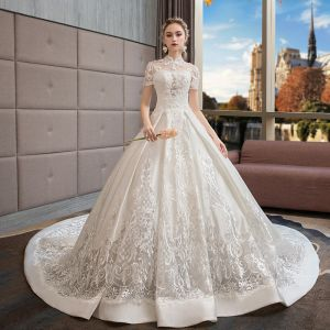 Stunning Ivory Wedding Dresses 2019 Ball Gown High Neck Pierced Appliques Beading Crystal Pearl Short Sleeve Backless Royal Train