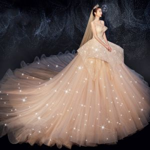 Bling Bling Champagne Wedding Dresses 2019 Ball Gown Sweetheart Sleeveless Backless Beading Glitter Tulle Cathedral Train Ruffle