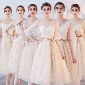 Asequible Champán Transparentes Vestidos De Damas De Honor 2018 A-Line / Princess Cinturón Té De Longitud Ruffle Sin Espalda Vestidos para bodas