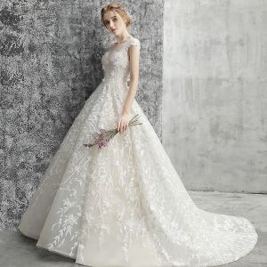 Modern / Fashion Champagne Pierced Wedding Dresses 2018 Ball Gown Scoop Neck Backless Cap Sleeves Appliques Lace Pearl Beading Chapel Train