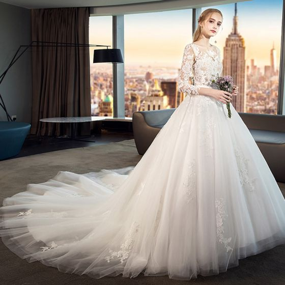712f0af479d4 modest-simple-white-wedding-dresses-2019-a-line -princess-scoop-neck-see-through-lace-flower-3-4-sleeve-backless-cathedral- train-560x560.jpg