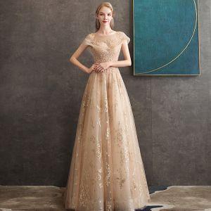 Beste Gold Durchsichtige Abendkleider 2020 A Linie Rundhalsausschnitt Kurze Ärmel Perlenstickerei Lange Rüschen Rückenfreies Festliche Kleider