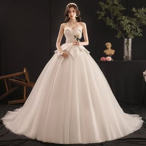 Charming Ivory Wedding Dresses 2019 Ball Gown Beading Pearl Sweetheart Sleeveless Backless Cathedral Train