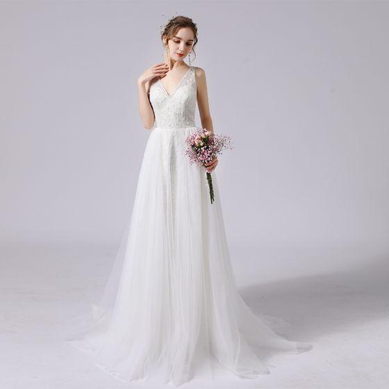 Elegant Ivory Glitter Wedding Dresses 2021 A-Line / Princess Beading V-Neck Sleeveless Backless Sweep Train Wedding