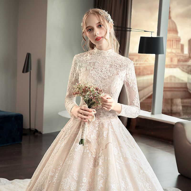 Illusion Champagne Pierced Wedding Dresses 2019 A-Line / Princess High Neck Long Sleeve Backless Appliques Lace Cathedral Train Ruffle
