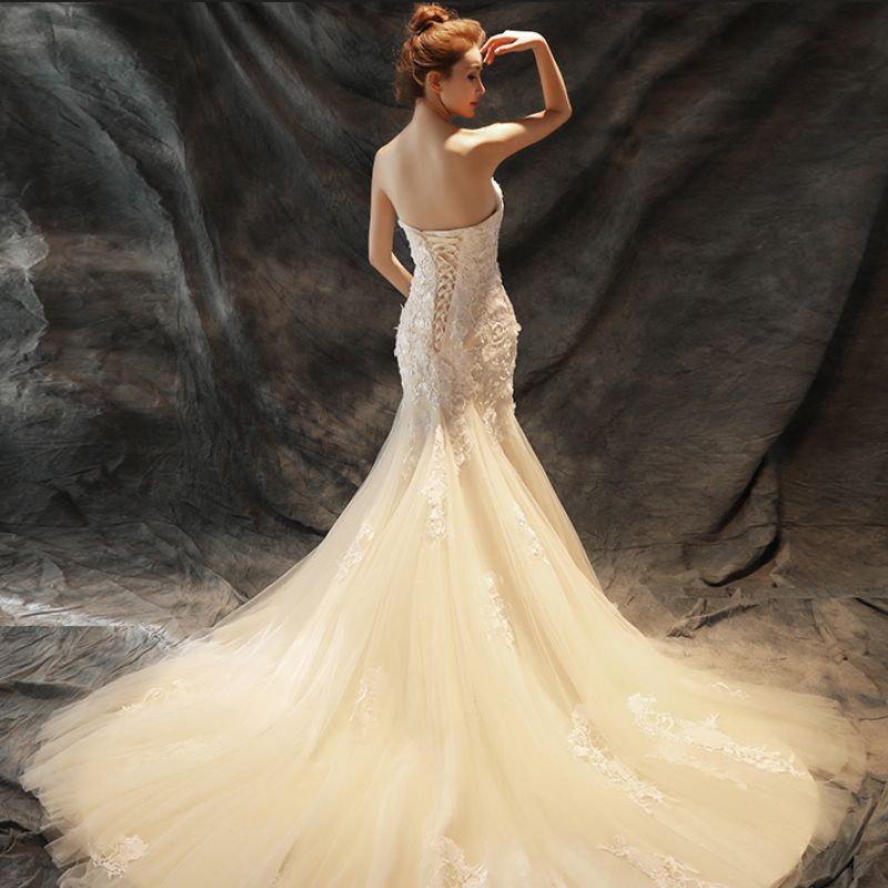 Chic / Beautiful Wedding Dresses 2017 Champagne Trumpet / Mermaid Chapel Train Cascading Ruffles Strapless Sleeveless Backless Lace Appliques Pearl