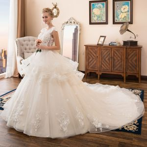 Illusion Ivory See-through Wedding Dresses 2018 Ball Gown Scoop Neck Sleeveless Appliques Flower Beading Pearl Cathedral Train Ruffle