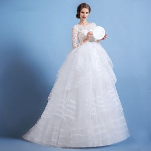 Stunning Ivory See-through Wedding Dresses 2018 Ball Gown Scoop Neck Long Sleeve Backless Beading Cascading Ruffles