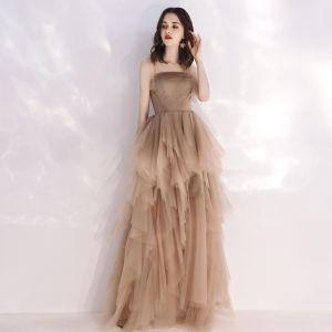 5fcb845f532a2f Niedrogie Szampan Lato Sukienki Wieczorowe 2019 Princessa Plecy Bez Rękawów  Długie Kaskadowe Falbany Bez Pleców Sukienki