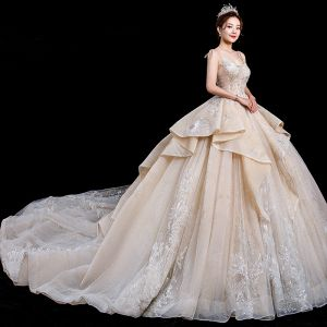 Stunning Champagne Wedding Dresses 2020 Ball Gown Spaghetti Straps Sleeveless Backless Glitter Tulle Appliques Lace Beading Royal Train Ruffle