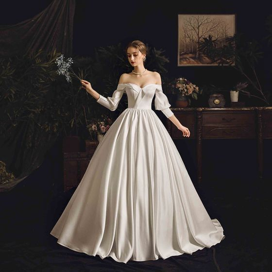 Modest / Simple Ivory Satin Wedding Dresses 2019 Princess Off-The-Shoulder Puffy 3/4 Sleeve Backless Chapel Train Ruffle