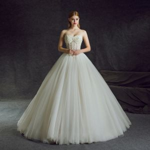 Illusion Ivory Pierced Wedding Dresses 2018 Ball Gown Sweetheart Sleeveless Backless Beading Pearl Rhinestone Ruffle Chapel Train
