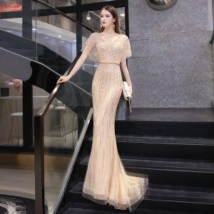 High End Gold Durchsichtige Abendkleider 2020 Meerjungfrau V-Ausschnitt Kurze Ärmel Stoffgürtel Perlenstickerei Sweep / Pinsel Zug Rüschen Festliche Kleider