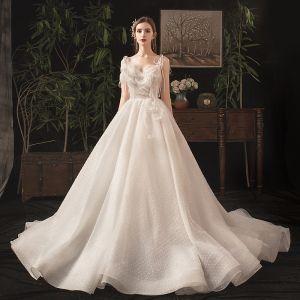 Charming Ivory Wedding Dresses 2019 A-Line / Princess Spaghetti Straps Bow Beading Lace Sleeveless Backless Chapel Train