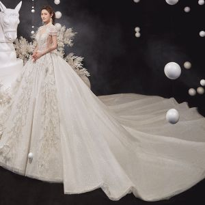 Luxury / Gorgeous Champagne See-through Bridal Wedding Dresses 2020 Ball Gown High Neck Short Sleeve Appliques Lace Beading Tassel Glitter Tulle Cathedral Train