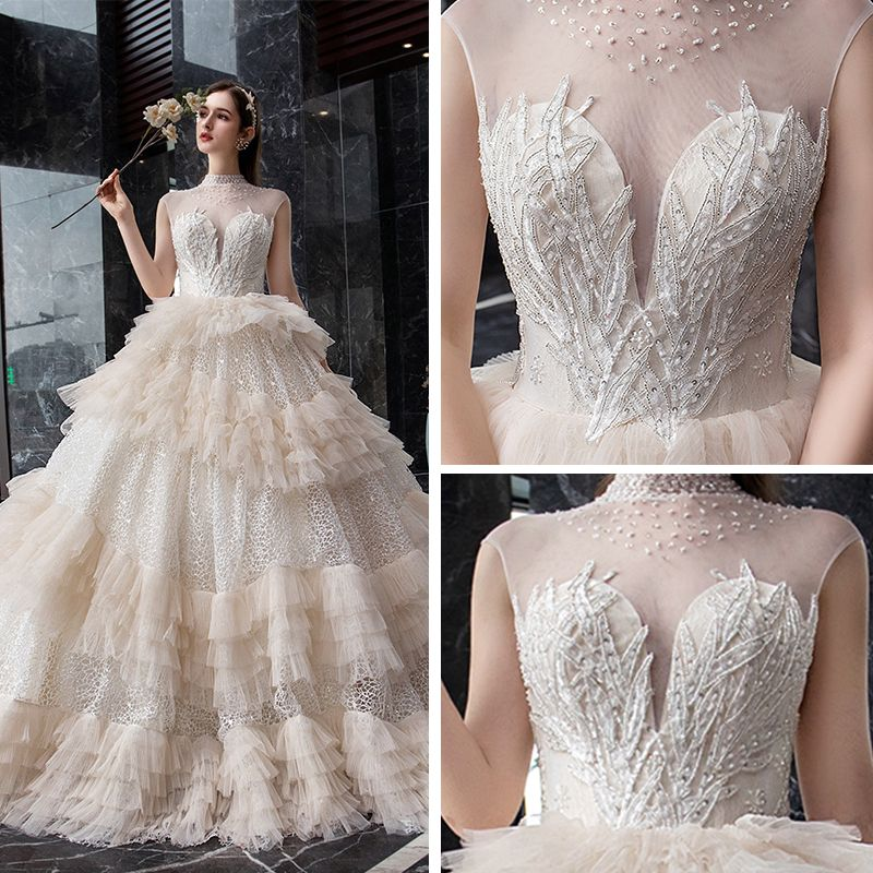 Fabulous Champagne Glitter Lace Wedding Dresses 2019 Ball Gown See-through High Neck Sleeveless Backless Beading Cathedral Train Ruffle