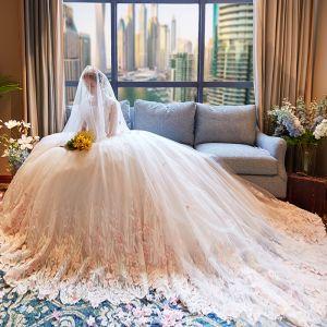 Glamour Ivoire Transparentes Robe De Mariée 2019 Princesse Encolure Dégagée 3/4 Manches Perlage Appliques En Dentelle Fleur Chapel Train Volants