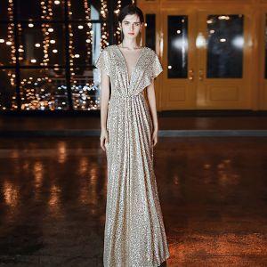 Błyszczące Złote Sukienki Wieczorowe 2020 Princessa Wycięciem Cekiny Kótkie Rękawy Bez Pleców Długie Sukienki Wizytowe