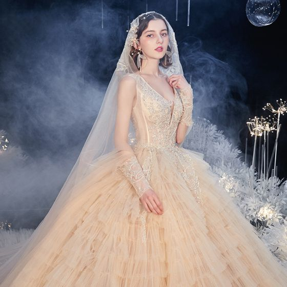 Stunning Champagne Bridal Wedding Dresses 2020 Ball Gown Deep V-Neck Long Sleeve Backless Appliques Beading Glitter Tulle Cathedral Train Cascading Ruffles