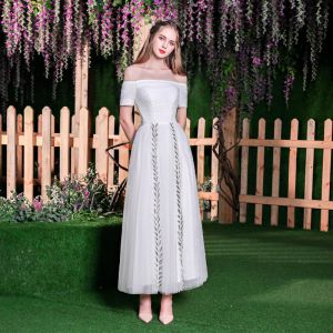 Modest / Simple Ivory Beach Wedding Dresses 2018 A-Line / Princess Sequins Ruffle Off-The-Shoulder Backless Short Sleeve Tea-length Wedding