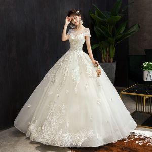 Elegante Champagner Brautkleider / Hochzeitskleider 2019 Ballkleid Rundhalsausschnitt Perlenstickerei Spitze Blumen Kurze Ärmel Rückenfreies Lange