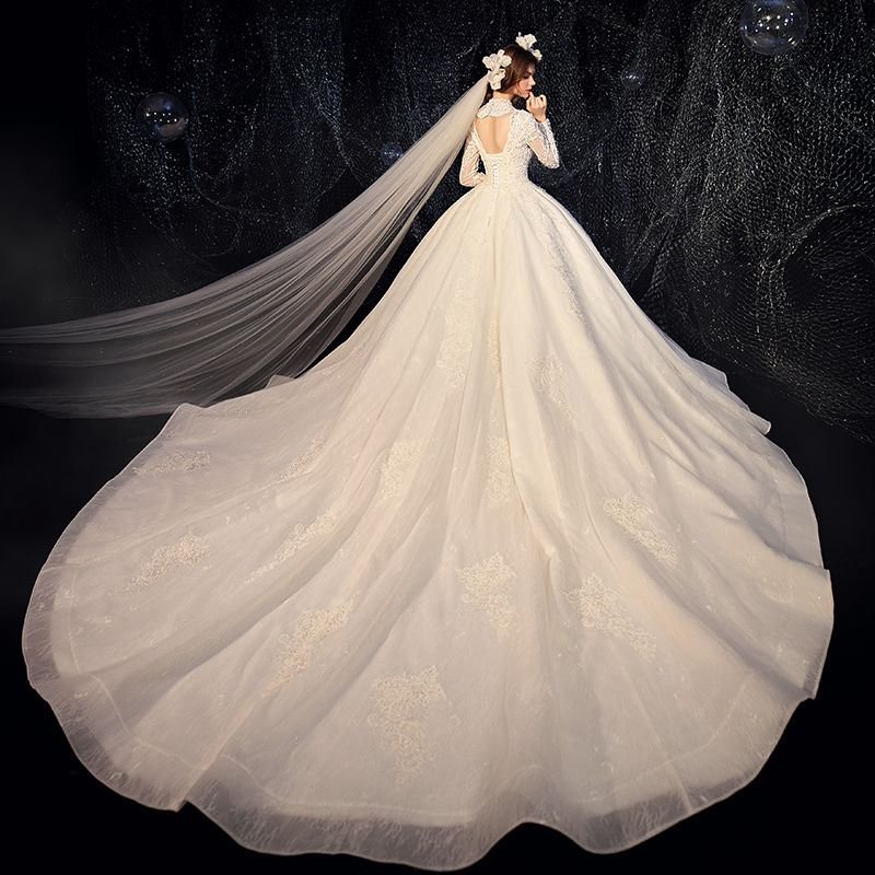 Chic / Beautiful Champagne Wedding Dresses 2020 Ball Gown Deep V-Neck Long Sleeve Backless Glitter Tulle Pierced Appliques Lace Beading Pearl Cathedral Train Ruffle