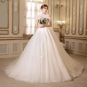 Elegant See-through Champagne Wedding Dresses 2018 A-Line / Princess High Neck Strapless Sleeveless Appliques Lace Beading Cathedral Train Ruffle