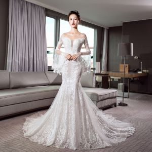 Luxury / Gorgeous Ivory See-through Wedding Dresses 2018 Trumpet / Mermaid Off-The-Shoulder Bell sleeves Backless Appliques Lace Glitter Tulle Chapel Train Ruffle