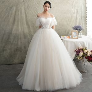Elegant Ivory See-through Wedding Dresses 2019 Princess Off-The-Shoulder Short Sleeve Backless Beading Sweep Train Ruffle