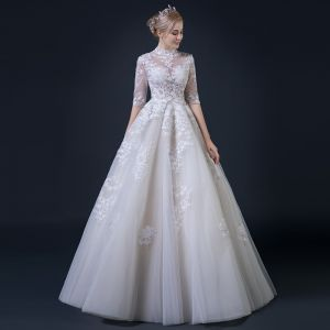 Illusion Champagne Pierced Wedding Dresses 2018 A-Line / Princess High Neck 1/2 Sleeves Appliques Lace Ruffle Floor-Length / Long