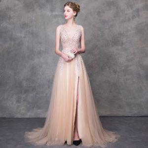 Luxus / Herrlich Champagner Abendkleider 2018 A Linie Perlenstickerei Pailletten V-Ausschnitt Rückenfreies Ärmellos Sweep / Pinsel Zug Festliche Kleider