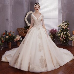 Charming Champagne Wedding Dresses Ball Gown 2019 Deep V-Neck Beading Tassel Pearl Lace Flower Sequins Short Sleeve Backless Royal Train
