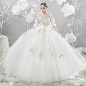 Niedrogie Białe Przezroczyste Suknie Ślubne 2018 Princessa Wycięciem Kótkie Rękawy Bez Pleców Złote Aplikacje Z Koronki Frezowanie Wzburzyć Trenem Katedra