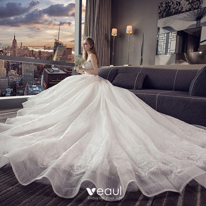 Affordable Ivory Wedding Dresses 2019 A-Line / Princess Strapless Sleeveless Backless Appliques Lace Chapel Train Ruffle