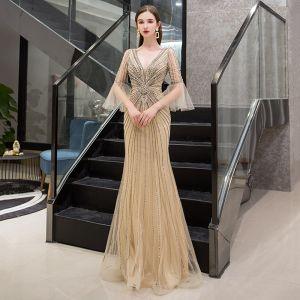 Luxus / Herrlich Gold Abendkleider 2019 Meerjungfrau Tiefer V-Ausschnitt Glockenhülsen Handgefertigt Pailletten Perlenstickerei Lange Rüschen Rückenfreies Festliche Kleider