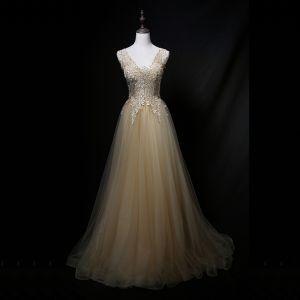 Charming Gold Prom Dresses 2018 A-Line / Princess V-Neck Sleeveless Appliques Lace Rhinestone Sweep Train Ruffle Backless Formal Dresses