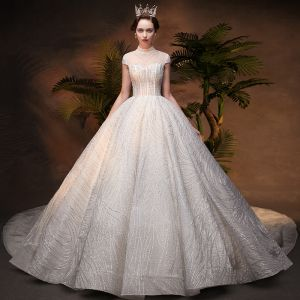 Luxury / Gorgeous Ivory See-through Wedding Dresses 2019 Ball Gown High Neck Cap Sleeves Backless Handmade  Beading Glitter Sequins Chapel Train Ruffle