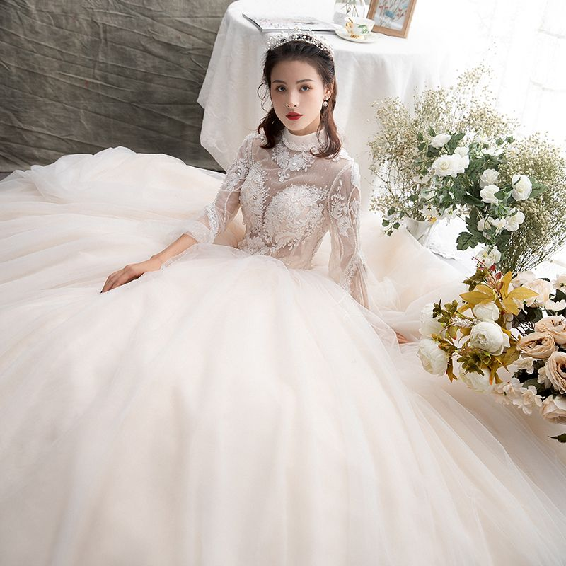 Illusion Champagne See-through Wedding Dresses 2019 A-Line / Princess High Neck Long Sleeve Backless Appliques Lace Beading Floor-Length / Long Ruffle