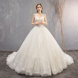 Elegant Ivory Wedding Dresses 2019 Ball Gown Spaghetti Straps Beading Sequins Lace Flower Sleeveless Backless Cathedral Train