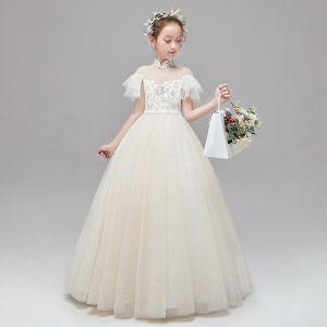 Piękne Szampan Sukienki Dla Dziewczynek 2020 Princessa Przezroczyste Wysokiej Szyi Kótkie Rękawy Aplikacje Z Koronki Frezowanie Perła Długie Wzburzyć