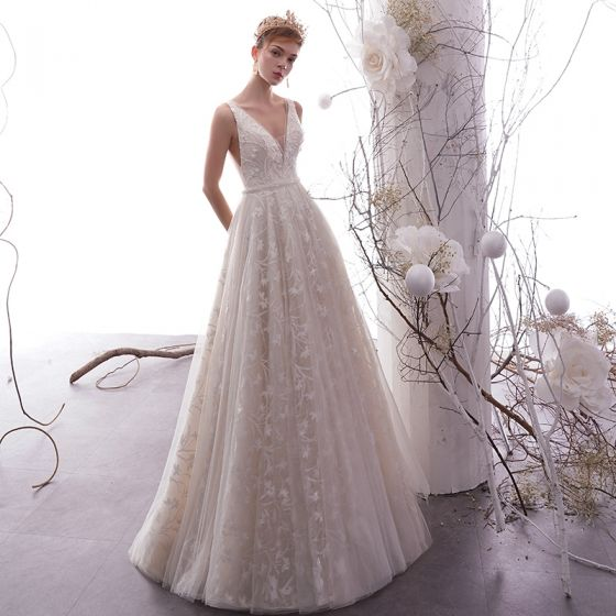 ab14975ac4 best-champagne-outdoor-garden-wedding-dresses-2019-empire-deep-v-neck- sleeveless-backless-appliques-lace-beading-pearl-floor-length-long -ruffle-560x560.jpg