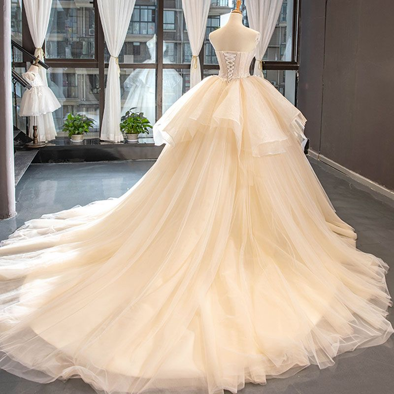 High-end Champagne Wedding Dresses 2019 Ball Gown Ruffle Strapless Lace Flower Sleeveless Backless Cascading Ruffles Royal Train