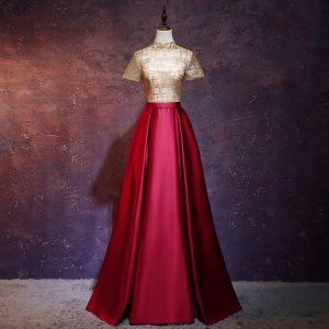 Mode Gold Rot Durchsichtige Abendkleider 2018 A Linie Stehkragen Kurze Ärmel Stoffgürtel Lange Rüschen Glanz Festliche Kleider