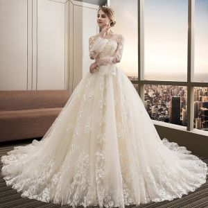 Stunning Champagne Wedding Dresses 2018 Ball Gown Lace Appliques Pearl Scoop Neck Backless Long Sleeve Royal Train Wedding
