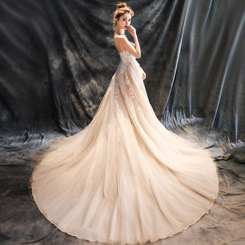 Romantic Beach Wedding Dresses 2017 A-Line / Princess Sleeveless Spaghetti Straps Appliques Lace Flower Beading Backless Champagne Ruffle Tulle Chapel Train