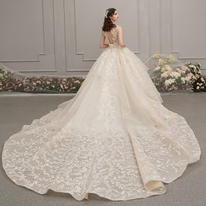 Romantic Champagne See-through Wedding Dresses 2019 Ball Gown Scoop Neck Sleeveless Backless Glitter Appliques Lace Beading Cathedral Train Ruffle