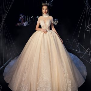 Fabulous Champagne See-through Wedding Dresses 2019 Ball Gown High Neck Short Sleeve Backless Appliques Lace Beading Glitter Tulle Cathedral Train Ruffle