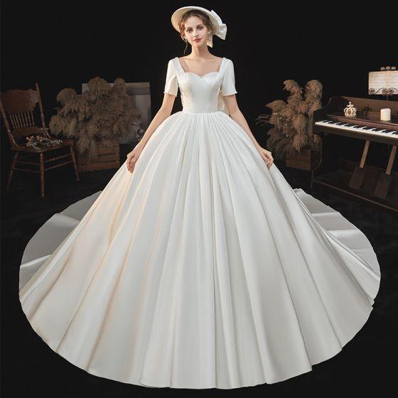 High-end Elegant Ivory Satin Wedding Dresses 2021 Ball Gown Pearl Square Neckline Short Sleeve Backless Bow Royal Train Wedding