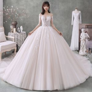 Fabulous Champagne See-through Wedding Dresses 2020 Ball Gown Scoop Neck 3/4 Sleeve Backless Appliques Lace Beading Cathedral Train Ruffle